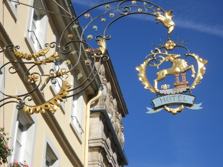 Beautiful brass and gold signs adorn the shops.